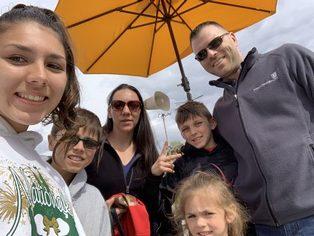 Teicher family photo with yellow umbrella
